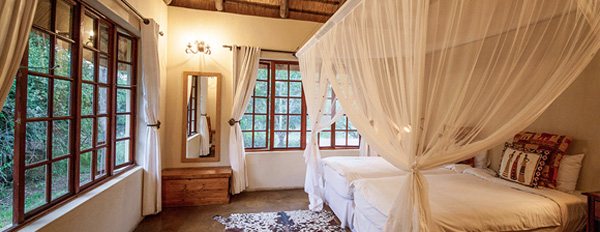 The Cottage, Twin bedroom at Rhino River Lodge in the Big 5 Manyoni Private Game Reserve (previously the Zululand Rhino Reserve), KwaZulu-Natal