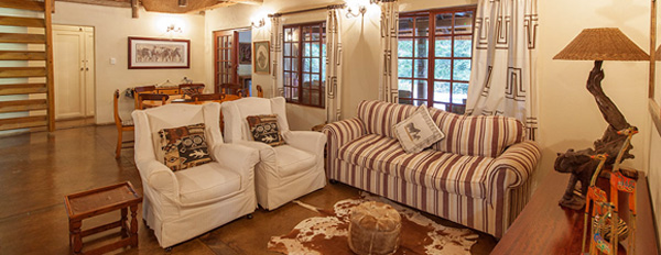 The Cottage, Open plan Lounge at Rhino River Lodge in the Manyoni Private Game Reserve (Zululand Rhino Reserve) located in KwaZulu-Natal