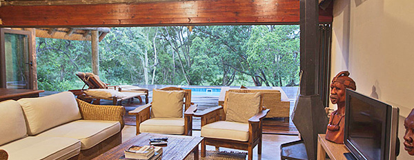 The Homestead, Lounge looking onto the Deck area at Rhino River Lodge in the Big 5 Manyoni Private Game Reserve (Zululand Rhino Reserve) located in KwaZulu-Natal, South Africa